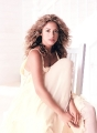 Shakira posing in white glamorous dress