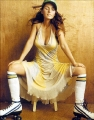 Shania Twain posing in awesome dress with hot neckline