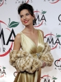 Shania Twain dressed in hot golden dress with plunging neckline