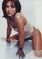 Shannen Doherty sitting in the water in incredibly sexy shimmy
