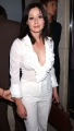 Shannen Doherty posing in white sexy dress