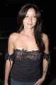 Shannen Doherty wearing black hot dress with awesome neckline