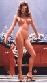 Shannon Elizabeth posing nude by the stylish car