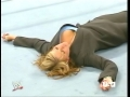 Stephanie McMahon laying on the ring
