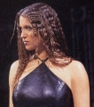 Curly haired Stephanie McMahon wearing black hot dress