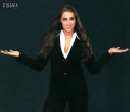 Stephanie McMahon posing in black sexy dress