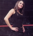Stephanie McMahon wearing black hot dress