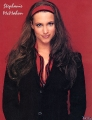 Stephanie McMahon posing in black nice dress