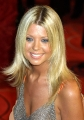 Tara Reid posing in sexy silver dress with plunging neckline