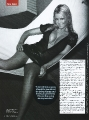 Tara Reid posing in black hot dress with awesome neckline
