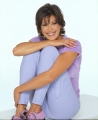 Teri Hatcher smiling dressed in violet