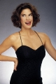 Teri Hatcher smiling wearing hot dress with plunging neckline
