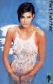 Teri Hatcher posing in wet hot dress inside the pool
