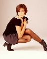 Teri Hatcher posing in black hot dress