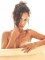 Tia Carrere taking bath topless