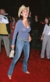 Tia Carrere wearing blue hot dress