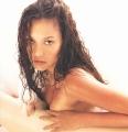 Tia Carrere posing topless