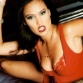 Tia Carrere wearing incredibly hot dress with sexy neckline