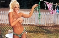 Topless Torrie Wilson changing up bikini
