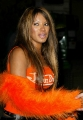 Traci Bingham wearing hot orange dress