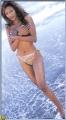 Traci Bingham posing topless wearing sexy tiny tanga