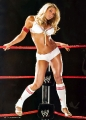 Trish Stratus posing on WWE Ring wearing hot lingerie