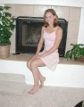 Lacey White posing by the fireplace