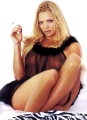 Jaime Pressly is smoking a cigarette in black transparent lingerie