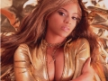 Beyonce Knowles wearing sexy golden jacket