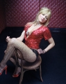 Jewel Kilcher posing in hot dress