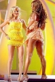 Beyonce Knowles on stage with yellow friend