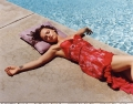 Christina Ricci in red lingerie laying by the swimming pool