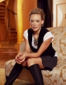 Hilary Duff posing on the couch