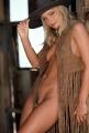 Jaime Pressly posing nude in a cowboy suite